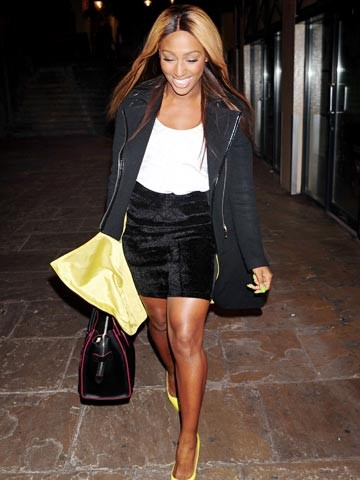 Short Mini black skirt teamed with a white blouse and overall black trench coat