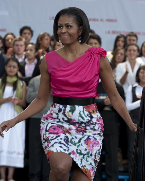 US First Lady Michelle Obama gets on sta