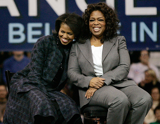 December 9, 2007: Michelle Obama and Oprah Winfrey sit together during a ra