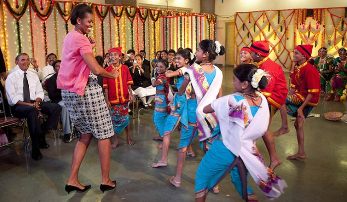 November 7, 2010: First Lady Michelle Obama dances at a cultural event at a