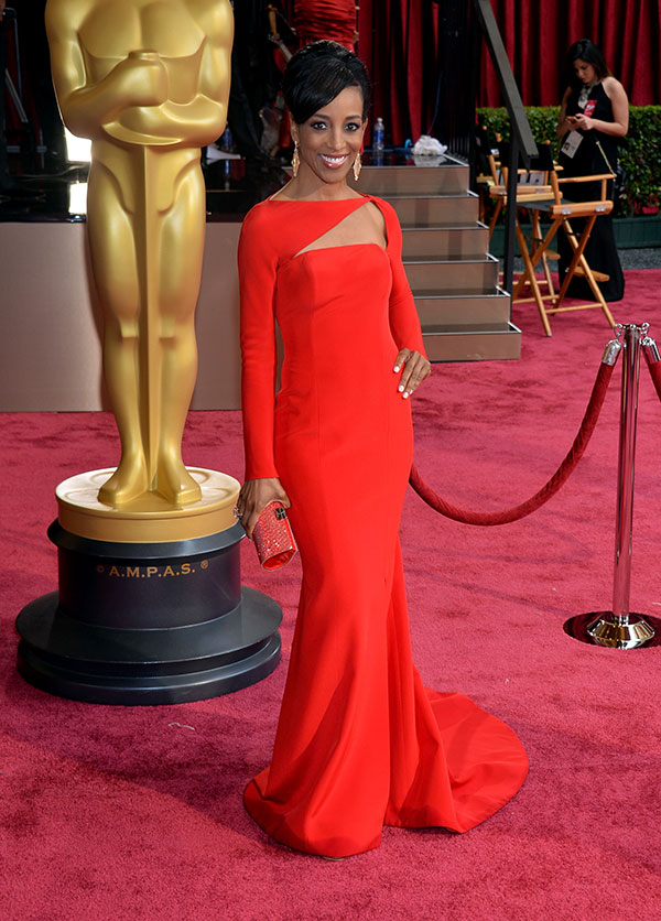 Shaun Robinson showed off her toned curves in a Romona Keveza gown, which has a short train and a knee-high slit.