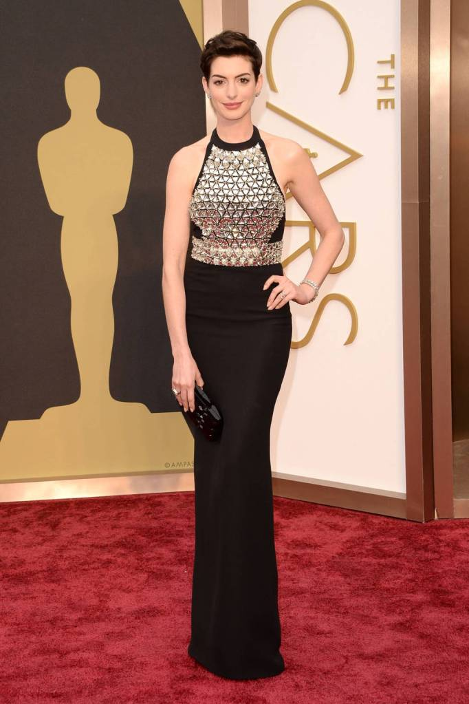 Anne Hathaway in a black silk crepe Gucci dress with a crystal embroidered bodice.